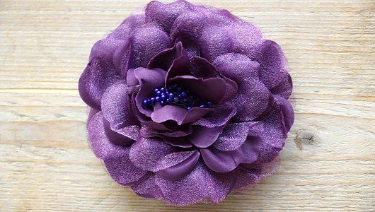 Paarse corsage