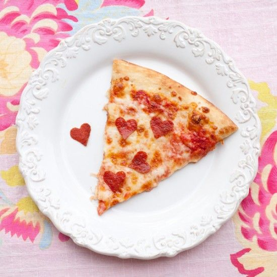 Make a special Valentine's Day dinner at home for your kids (or your sweetie). Add some heart shaped pepperonis to a store bought or homemade pizza. It's so easy. Just buy sliced pepperoni, cut heart shapes out with a small cookie cutter, and add to the pizza before cooking. This is would be a sweet addition to any Valentine's Party as well.