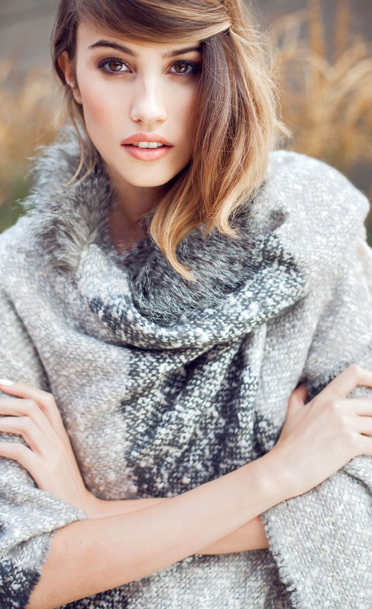 Be seen in the cover up of the season with our Cadi Check Textured Blanket Cape.