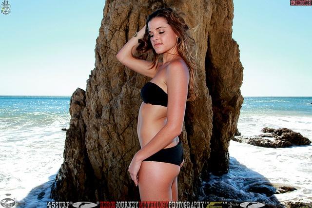 Photoshoot of a pretty swimsuit bikini model.    In a black bikini!     This Summer Enjoys  with an excellent body and healthBlack Bikini