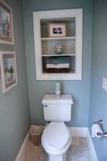for in the toilet room to make it look bigger and to store toilet paper, scenery photos nick nacks