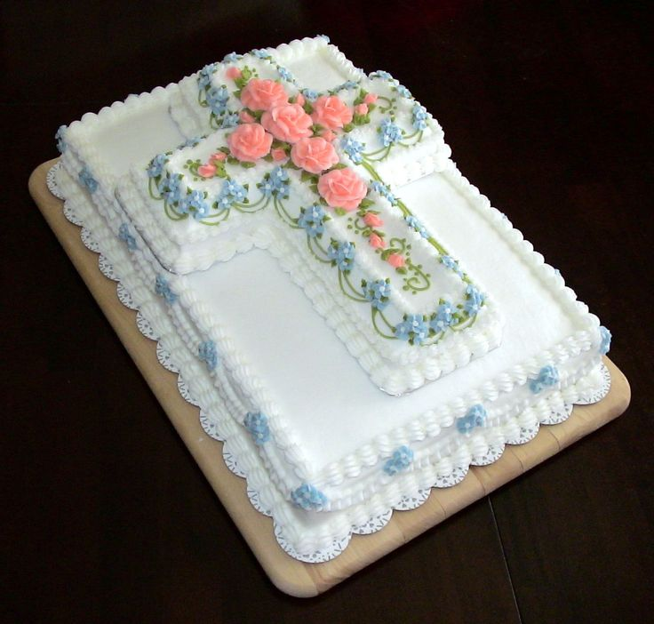 Peach cross - This cake was done in buttercream. It was actually for the funeral of a family member, but would make a lovely baptism or communion cake as well. I used Wilton's cross pan and accented the base cake (12x18) with drop strings and drop flowers.