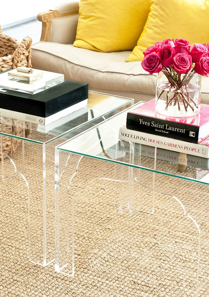 A clear center table is a great furniture piece for a small living room since it doesn't take up much visual space. #homedecor #centertable #livingroominspiration