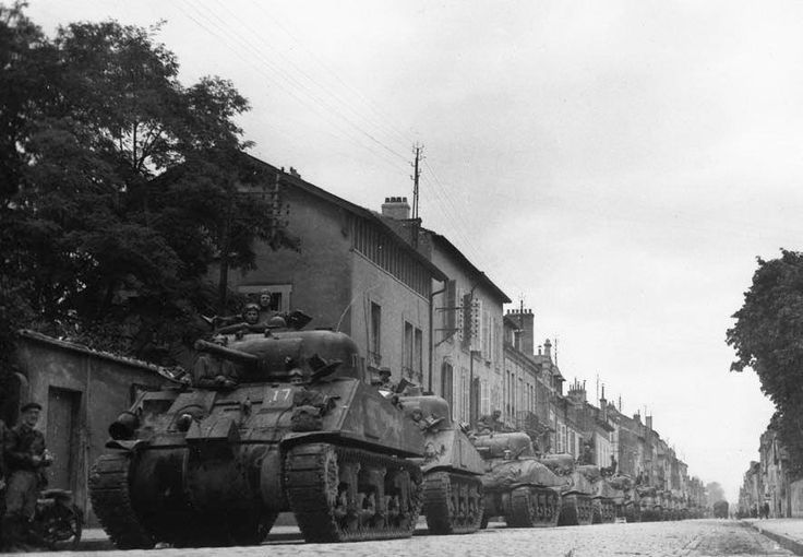 M4 Sherman medium tanks of the 749th Tank Battalion, attached to the 79th Infantry Division, lined up along a street in Luneville, France, in the fall of 1944.