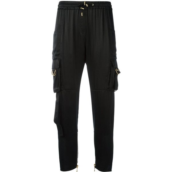 Balmain cargo trousers ($885) ❤ liked on Polyvore featuring pants, black, slouch pants, slouchy pants, stretch waist cargo pants, draw string pants and cargo pants