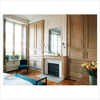 built-in wardrobes on each side of fireplace, mirror above fireplace, panelling