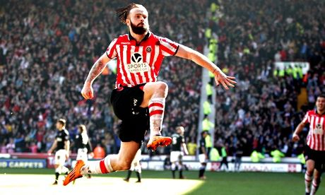John Brayford, the Sheffield United full-back, celebrates scoring the second goal against Charlton Athletic in the FA Cup quarter final