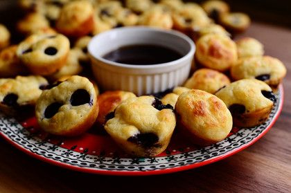 Pancake Mini Muffins.  Serve with warm syrup.  Very simple and EASY!  Great idea...maybe also good for a trip or camping!?