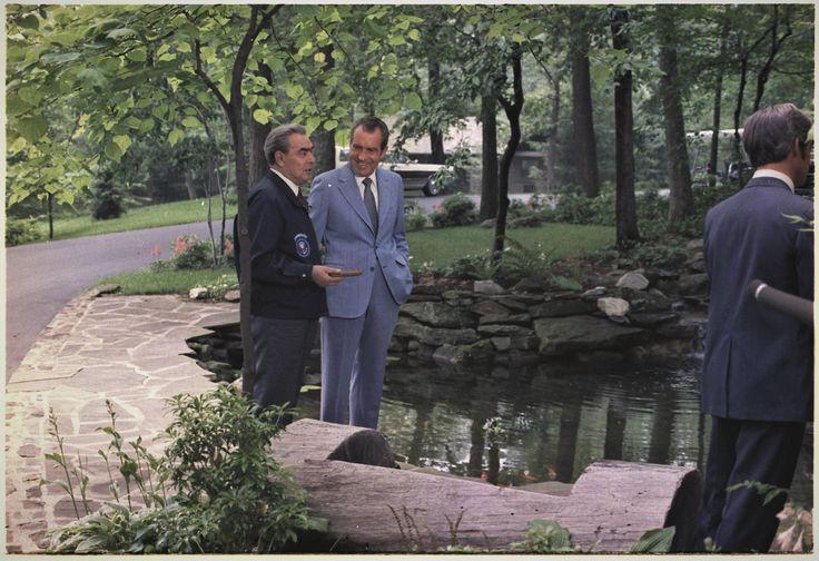 Richard M. Nixon and Leonid Brezhnev talking outside at Camp David 1973 [3000 x 2055]