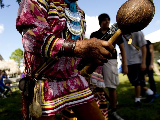 Tampa area Seminole, Bobby Henry leads a group of visitors at Big Cypress Seminole Reservation on demonstration of a traditional welcome  stomp dance.