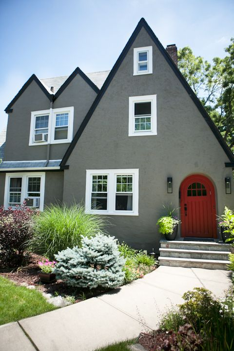 Attractive Unconventional Exterior Paint Treatment On Traditional Tudor Cottage.