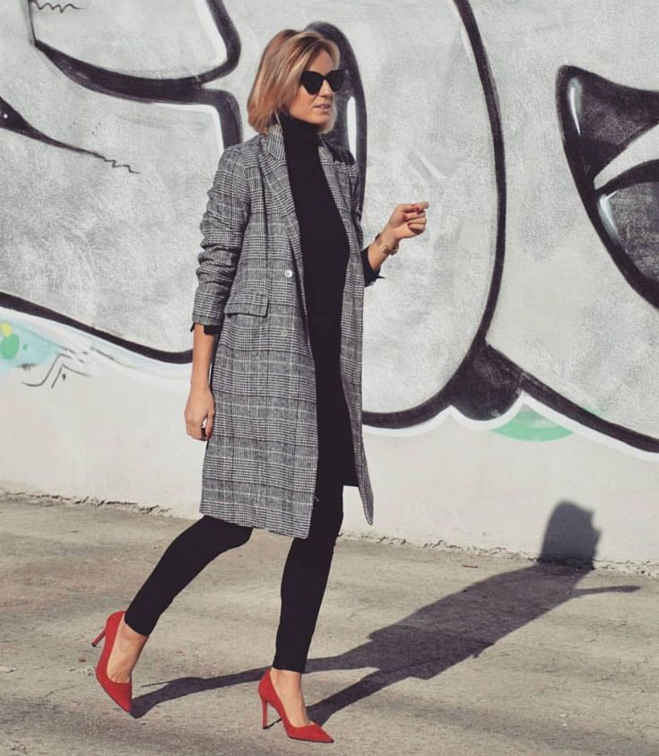 Black and white checked coat over all black with red heels.