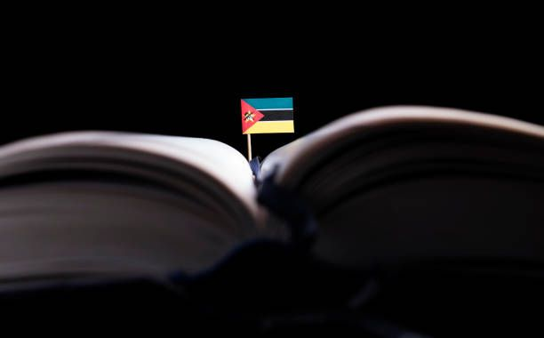 mozambique flag in the middle of the book knowledge and education