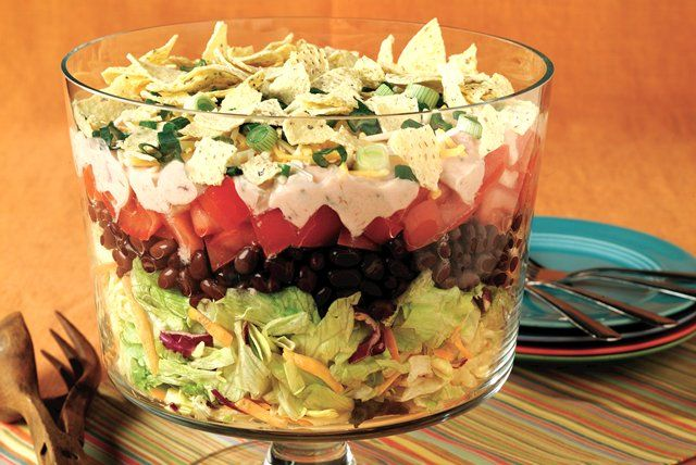 What happens while this chills in the fridge is a mystery, but somehow its layered ingredients transform into a deliciously smart salad. Like magic.
