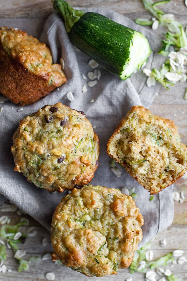 You won't find any butter or oil in these ridiculously soft and tender Zucchini Oat Greek Yogurt Muffins! They're perfect for breakfast or healthy snacking.