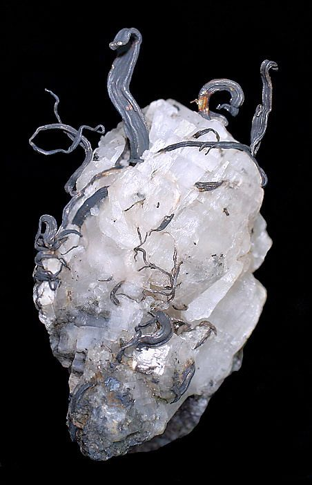 Wires of native silver emerging from a calcite crystal. Source: Kongsberg Silver Mining District, Svene, Flesberg, Buskerud, Norway. / Mineral Friends <3
