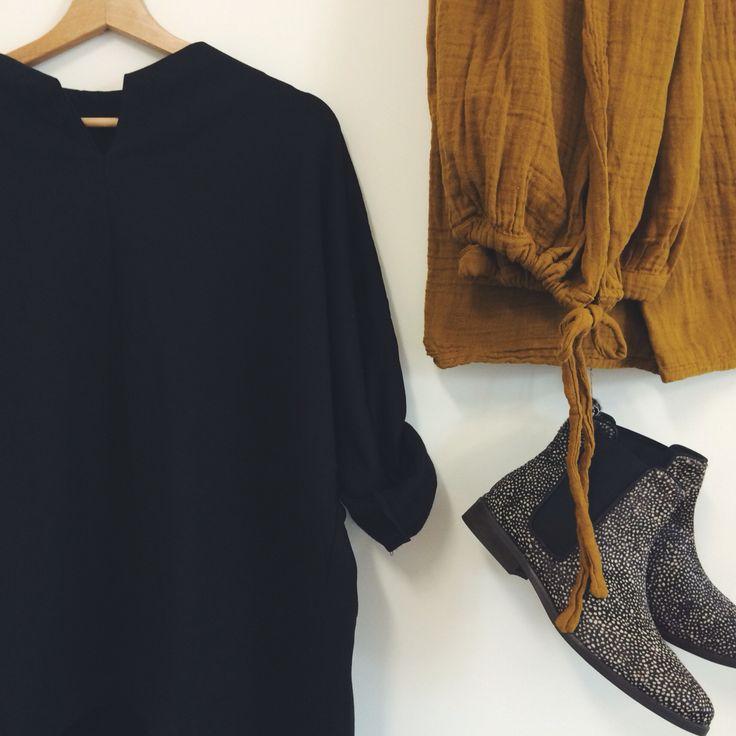 Women fashion. Black blouse By The Moon. Mustard skirt Numero 74. Maruti shoes.