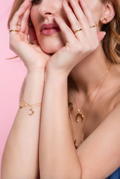 WILD collection, jewellery photoshoot, moon bracelet, necklace, covered with gold, model, pink background, ANIA KRUK