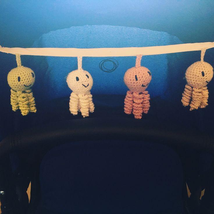 Crochet stroller toy.