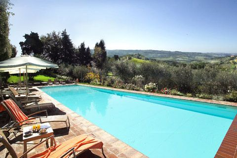 Villa Poggio San Felice, Florence, Italy. A lovely outdoor swimming pool with great views of the surrounding hills. #swimmingpool #italy #tuscany #florence