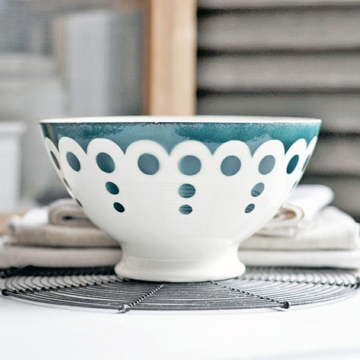 A vintage French cafe au lait bowl with green dots