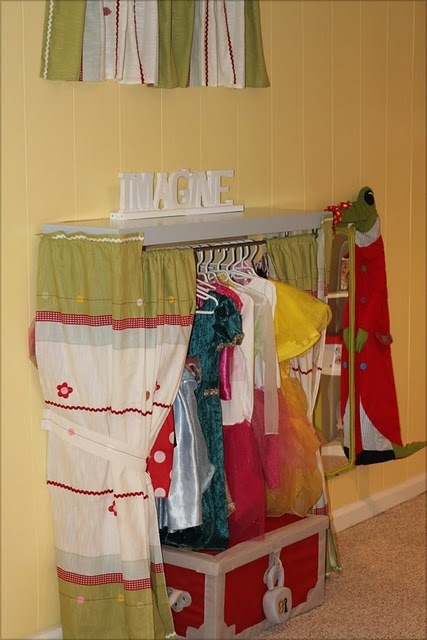 Simple and inexpensive dress up closet made from a shelf and curtain rod. or maybe adapt for a puppet theatre?