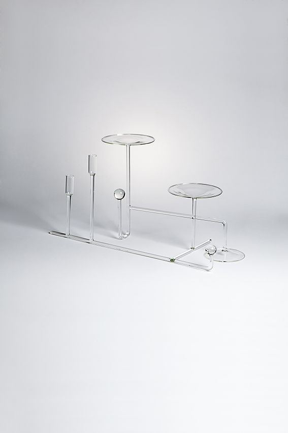 """NATURA MORTA designed by Valentina Carretta - Natura Morta is an omage to Art. Two simple geometric structures composed by glass tubes can be placed together and adorned with candle sticks, flowers and small fruits, as a beautiful centrepiece. The glass acts as a """"podium"""" for those common elements populating our tables – reminiscent of a classic Natura Morta painting. #drawingglass #fabricadesignstudio #fabrica #design #glass #valentinacarretta #massimolunardon"""