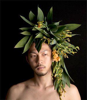 Floral headpiece on male model by Takaya Hanayuishi