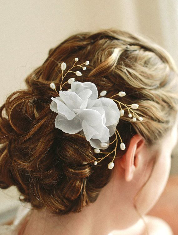 STYLE - #121 CODE: HRP002 Wired twigs and petals.Romantic hair pin features light and airy chiffon petals and wired pearls sprouting around.  Each pearl has been hand-wired to create rhythmic movement. To order yours contact us at loca@localoca.co.za www.localoca.co.za