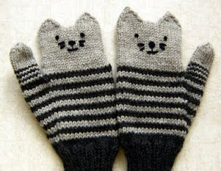 Kitten Mittens cuff up variation Elaine at Down Cloverlaine. A super cute pair of cat mittens knitted from the cuff up. I knew I had to make some of these as soon as I saw them.  I ended up making an orange mitten and a grey and black striped one. Free pattern.  Click here to get the pattern at Down Cloverlaine: http://downcloverlaine.blogspot.com/2009/11/kitten-mittens.html