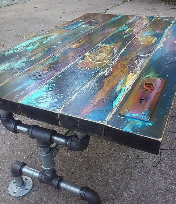 colorfully painted faux bronze weathered patina reclaimed wood coffee table vintage door pipe leg frame industrial art lover gift