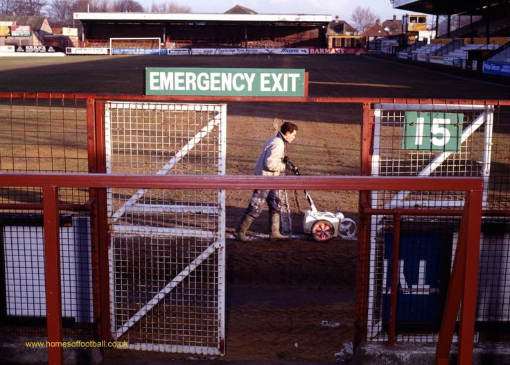 _0324 A bit of a slog, Cambridge United,England year1991 by Stuart Roy Clarke – The Abbey Stadium is not the best drained.