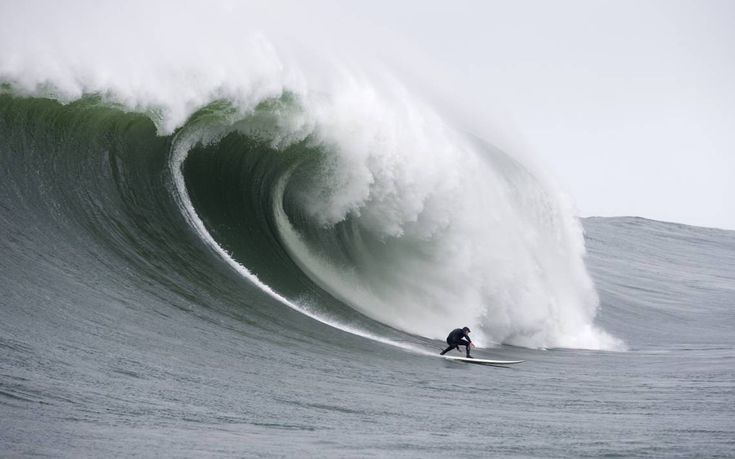 Mike Jones, owner of Azhiaziam surf shop in Morro Bay, took these photos Monday, Dec. 7, 2015, at Mavericks, California's famous big wave spot near Half Moon Bay.
