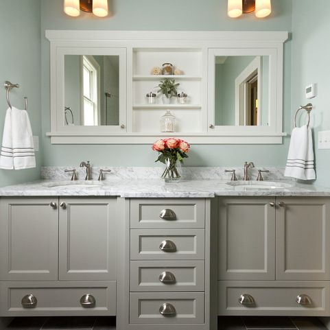 Love the built-in medicine cabinet/mirror combo and the vanity with drawers down the middle.