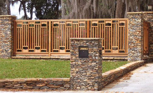 Ohh...now this is my cup of tea. Craftsman style wood and stonework fencing.