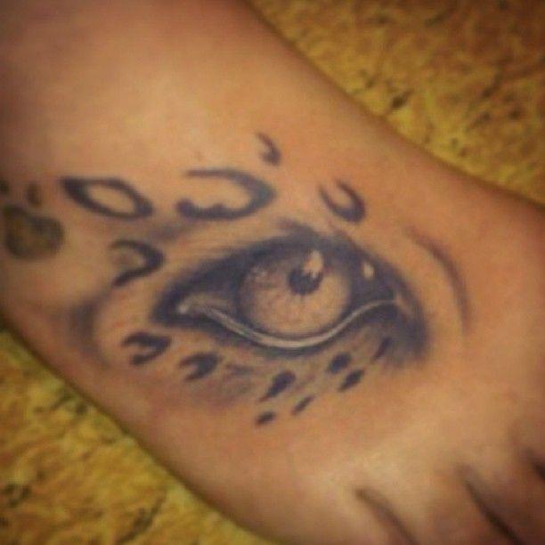 Leopard Eye Tattoo On Foot