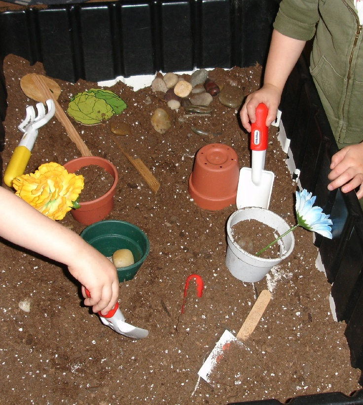Gardening in the sensory table.