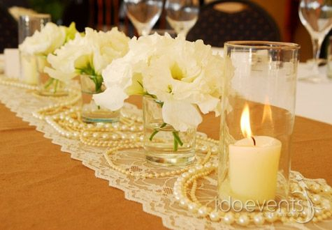 Pearls and lace, beautiful white fluffy flowers.. A simple, elegant centrepiece for those with long wedding tables!
