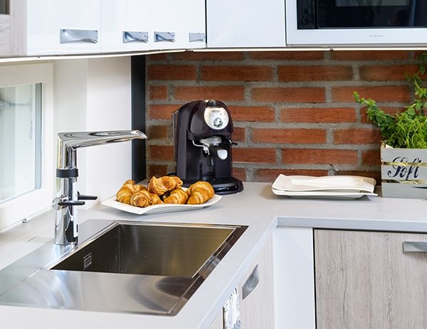 Faucet: Smart  Oras Optima kitchen faucet with a dishwasher valve and touchless function.