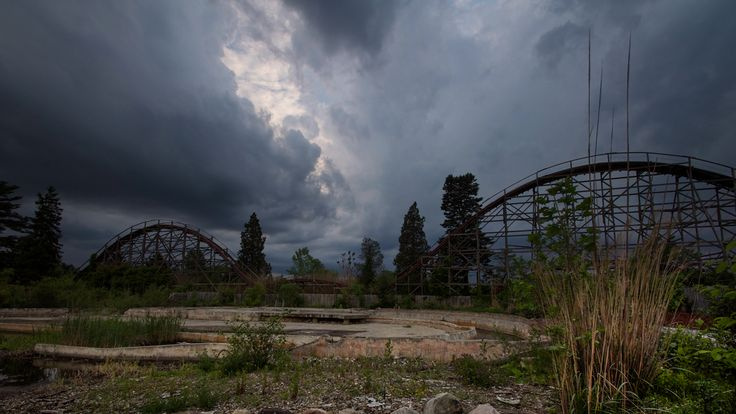 Photographer Seph Lawless' captures creepy, abandoned theme parks against stormy skies and fiery sunsets.