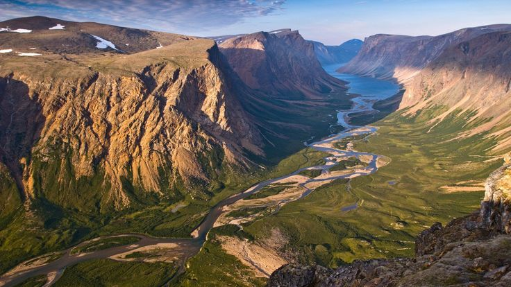 Want to get off the tourist-beaten track? Then look no farther than our northern neighbor, where a string of five national parks—with shifting ice and steep-walled fjords—peer over North America's 49th parallel.