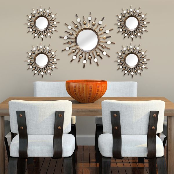 Decorate your home with this beautiful wall mirror set from Stratton Home Decor. These Burst Wall Mirrors will add stunning style to your home with this construction. Featuring gorgeous bronze colors,