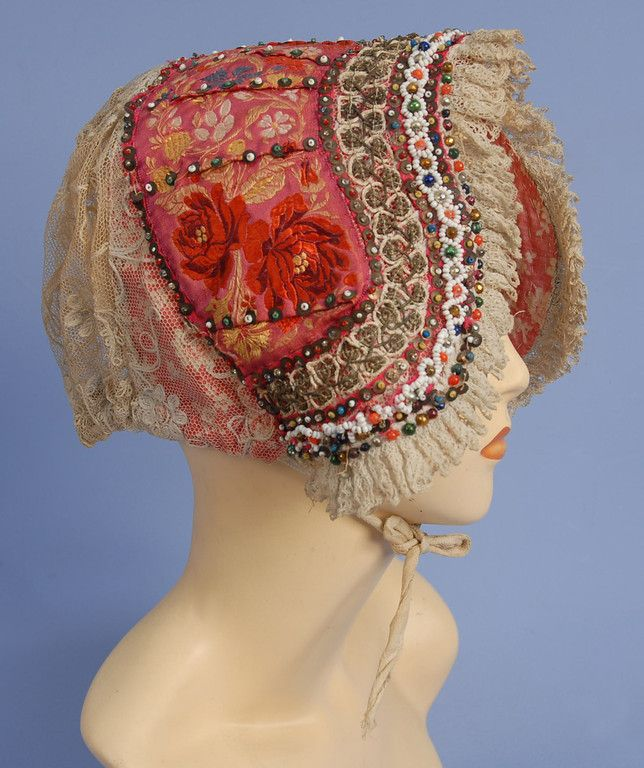 Bohemian wedding cap, colorful silk brocade with lace back and ruffle, decorated with sequins, colored beads and metallic gold cord, lined in printed cotton, 19th c