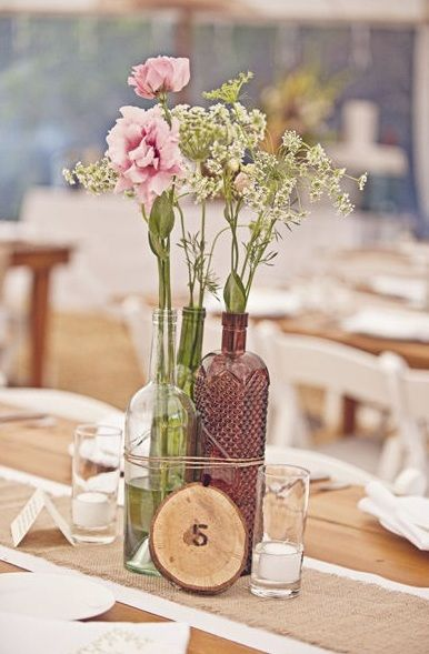 Wine bottle centerpiece wedding pinterest bottle for Wedding table decorations with wine bottles