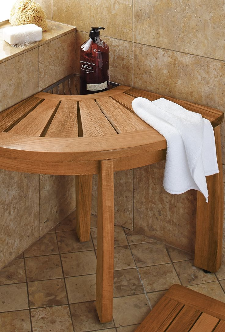 Our Teak Corner Shower Seat with Basket provides comfort and convenience, all in one.