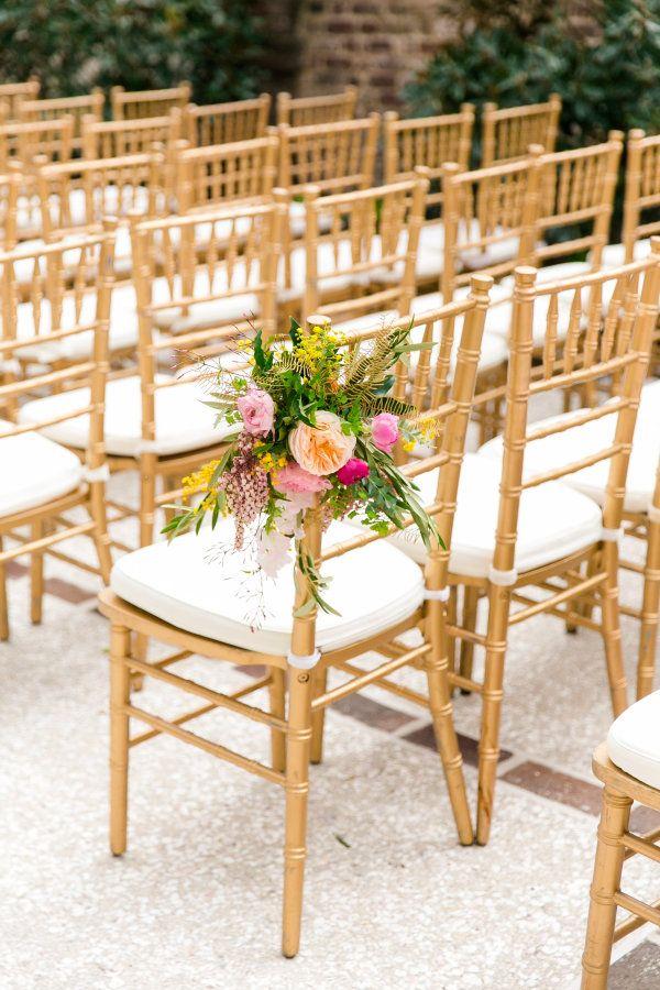 Elegant aisle flowers: http://www.stylemepretty.com/little-black-book-blog/2016/12/19/colorful-charleston-spring-wedding/ Photography: Dana Cubbage - http://danacubbageweddings.com/