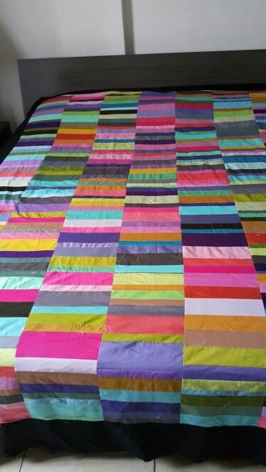 I made this broken bars quilt using instructions from the MIssouri Quilt Co. It's an excellent scrap buster - i kept a box in my sewing room of my scraps cut to size and then sewed it all together over a couple of days.