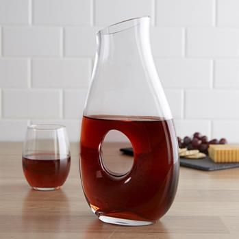 Bring out the full flavour and bouquet of your favourite wine with our Tuscana Wine Carafe.   Decanting wine lets it breathe, enhancing the flavours and helping remove unwanted sediment. The wide opening makes it easy to transfer your wine from the bottle to the carafe and the comfortable handle hold makes it easy to pour your decanted wine.
