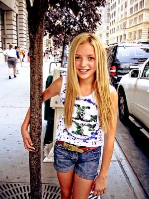 Peyton List I do not know how old she is but she looks 13 years old