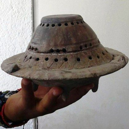 A curious Olmec artifact from pre-Columbian America. What purpose did it serve? Is it a model of something much bigger?